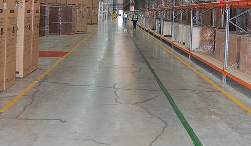 Concrete floor crack repair in warehouse